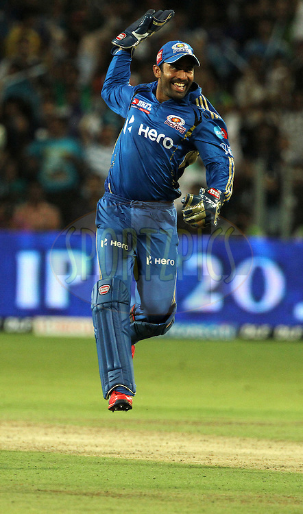Mumbai Indian player Dinesh Karthik celebrated after winning the match 45 of the Indian Premier League ( IPL) 2012  between The Pune Warriors India and the Mumbai Indians held at the Subrata Roy Sahara Stadium, Pune on the 3rd May 2012..Photo by Vipin Pawar/IPL/SPORTZPICS