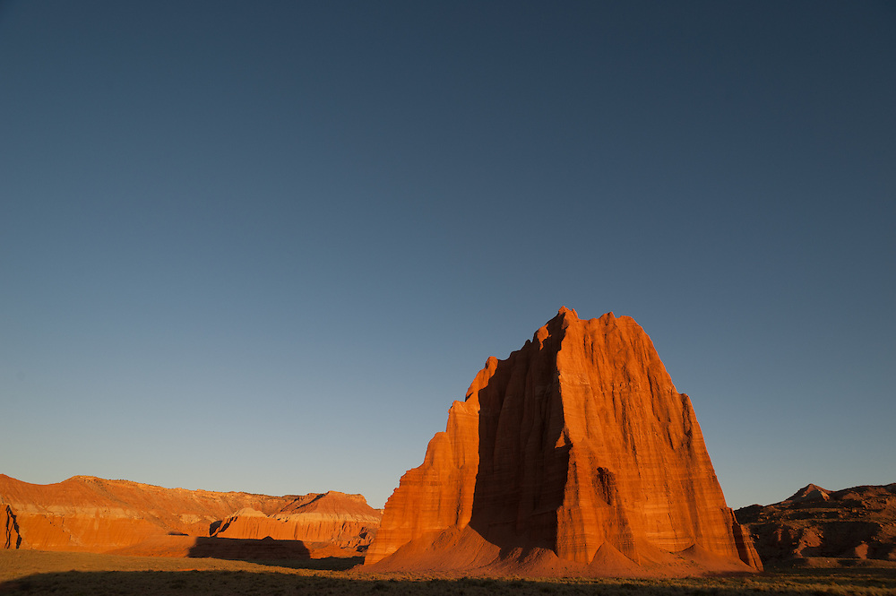 Temple of the Sun catches first light of dawn, Cathedral Valley Loop, Capitol Reef National Park, Utah