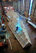 Athena, a three masted schooner, currently being built by the Royal Huisman Shipyard of Vollenhove, Holland will be the world's largest private sailing yacht when launched in the Fall of 2004.  The aluminum yacht is first constructed upside down from the waterline because it makes fabrication easier.   The underwater portion of the yacht is being moved to a construction shed that was specially built to accommodate the yacht whose length overall will be 295' (90m).