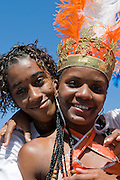 Colourful costumed, pretty , young woman with boyfriend. Carnival. Mindelo. Cabo Verde. Africa.