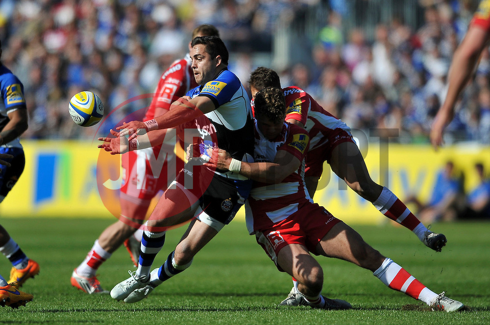 Horacio Agulla of Bath Rugby offloads the ball - Photo mandatory by-line: Patrick Khachfe/JMP - Mobile: 07966 386802 16/05/2015 - SPORT - RUGBY UNION - Bath - The Recreation Ground - Bath Rugby v Gloucester Rugby - Aviva Premiership