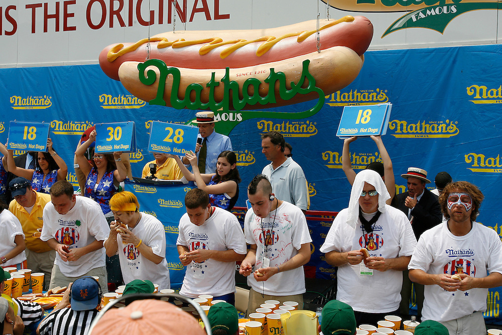 NEW YORK, NY-06 JUL04-- Competitors chow down during the hot dog eating competition. (Extra) The Gazette/Liam Maloney
