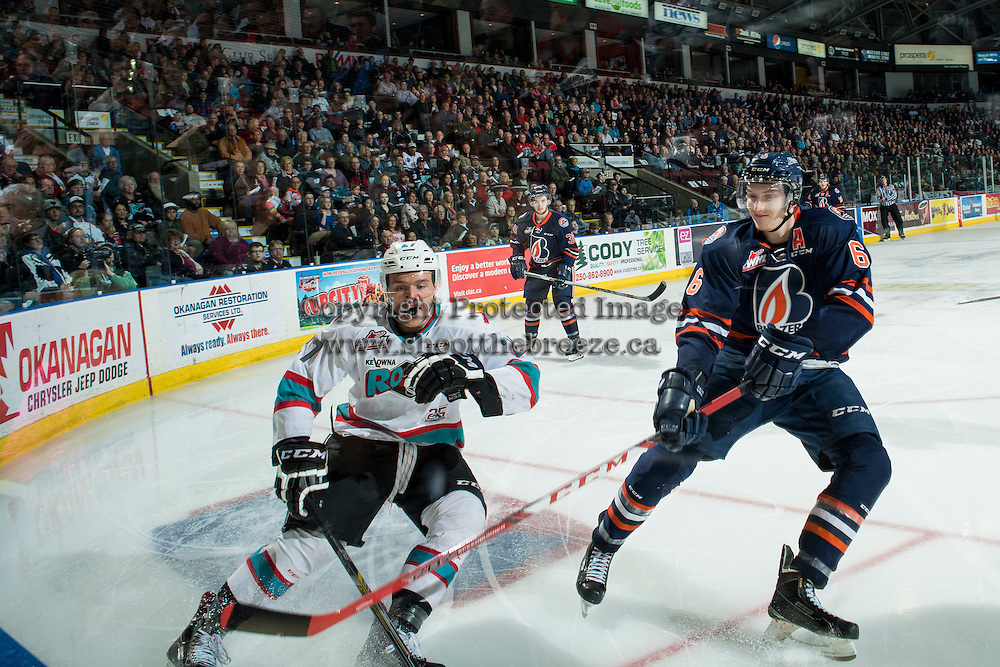 KELOWNA, CANADA - MARCH 25: Dallas Valentine #6 of Kamloops Blazers checks Calvin Thurkauf #27 of Kelowna Rockets on March 25, 2016 at Prospera Place in Kelowna, British Columbia, Canada.  (Photo by Marissa Baecker/Shoot the Breeze)  *** Local Caption *** Dallas Valentine; Calvin Thurkauf;