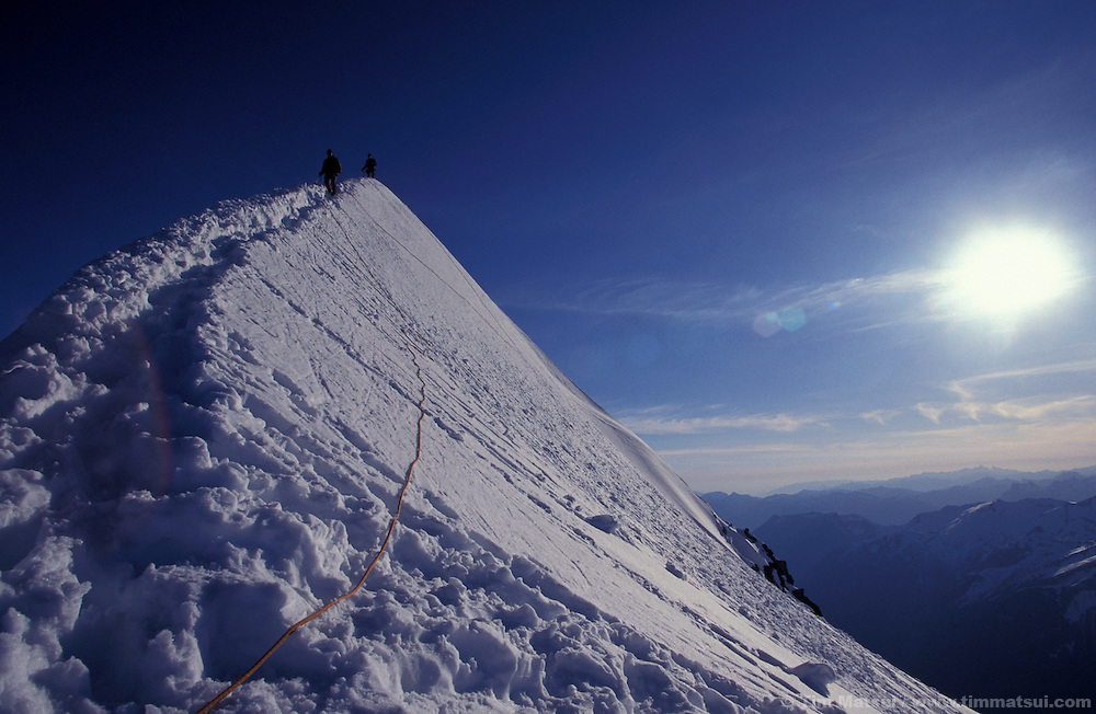 Climbers descend the snowy arete of El Dorado Peak in the North Cascades National Park.