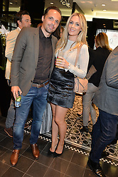 Footballer MATTHEW ETHERINGTON and his wife STEPHANIE ETHERINGTON at the Thomas sabo & Professional Player cocktail reception at Thomas sabo, 65 South Molton Street, London on 30th September 2015.