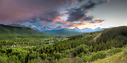 Sunset in Kananaskis Country, Alberta with approaching thunderstorm - August 2010.<br /> <br /> This photograph was taken along Highway 40 in Alberta during an amazing sunset and an incoming storm. The mountains in the background define the border with British Columbia, with the Highwood River peeking out here and there in the mid to background of the image, with mountain wildflowers gracing the foreground.<br /> <br /> This is 18 shot stitched panorama plus 2-exposure HDR treatment (2 rows of 9 photographs, 36 exposures total) taken with a Canon 40D, Canon TS-E 24 mm/3.5 L, and Nodal Ninja 5 panoramic head, shot very rapidly given quick moving clouds and rapidly changing light.<br /> <br /> What is memorable from the date this image was taken (besides this sunset) is that maybe 45 minutes earlier, while further west up the highway, near the Highwood Pass, I was into taking a macro shot of some wild-flowers by the side of the highway, with tripod set up maybe 0.15 m above ground (6-inches) with a 100 mm macro lens when my parents shouted from one of the two vehicles we were traveling in &quot;Bear!&quot;.<br /> <br /> A Grizzly mother and cub was crossing the highway maybe 125 m away from where I was shooting (moving away from us towards the river). So having wrong lens on camera, set up on tripod while lying on ground I certainly did not get that shot (they were in sight maybe 5-seconds total anyhow), and I rushed back to our vehicle as a precaution and we decided to move out and head back to my folks' home.<br /> <br /> Needless to say, maybe 30 km away from the bear later, I had the added pressure of my nervous father going on about me stopping again on the side of the highway to take these shots with bears &quot;around&quot;.