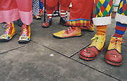 Pairs of colourful clown shoes, UK, 2003