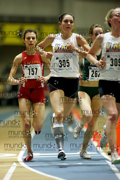 (Windsor, Ontario---12 March 2010) Courtney Laurie of University of Guelph Gryphons   Claire Jean of University of Victoria   competes in the 3000m final at the 2010 Canadian Interuniversity Sport Track and Field Championships at the St. Denis Center. Photograph copyright Sean Burges/Mundo Sport Images. www.mundosportimages.com