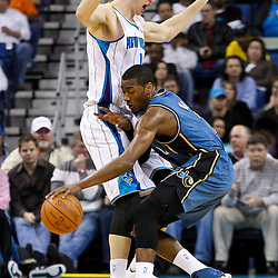 February 1, 2011; New Orleans, LA, USA; Washington Wizards point guard John Wall (2) collides with New Orleans Hornets power forward Jason Smith (14) during the second quarter at the New Orleans Arena.   Mandatory Credit: Derick E. Hingle