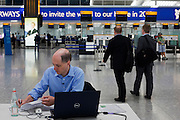 Heathrow writer-in-residence, Alain de Botton writes his airport novel in Departures at Heathrow Airport's Terminal 5.