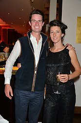 2012 Olympic Gold medalist PETER WILSON and his wife MICHELLE at a party to celebrate the 21st anniversary of The Roar Group hosted by Jonathan Shalit held at Avenue, 9 St.James's Street, London on 21st September 2015.