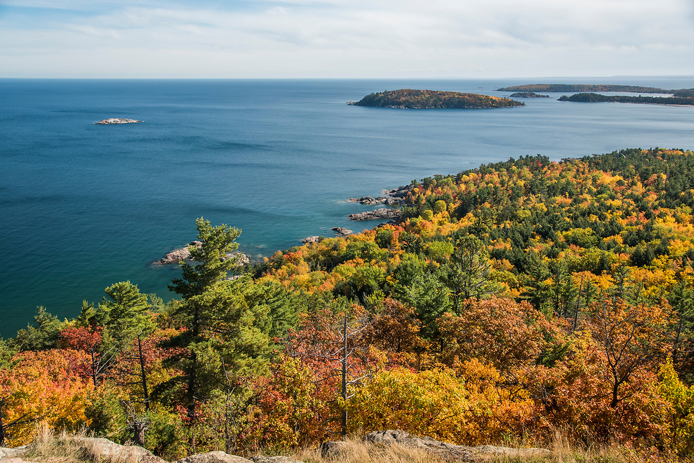 Fall color views of Lake Superior islands from atop Sugarloaf Mountain lookout near Marquette, Michigan.