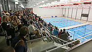 Members of the community attend the ribbon cutting at the new Linn-Mar Aquatic Center in Marion on Thursday, November 14, 2013.