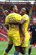 Goalscorer's AFC Wimbledon striker Tyrone Barnett (23) & AFC Wimbledon striker Dominic Poleon (10) celebrate during the EFL Sky Bet League 1 match between Charlton Athletic and AFC Wimbledon at The Valley, London, England on 17 September 2016. Photo by Stuart Butcher.
