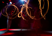 Pyro and Penumbra perform a fire-spinning act during Fire Ball X: Apocalypse at The Majestic Theater in Madison, Wisconsin., Saturday, Jan. 27, 2018.