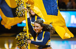 Jan 9, 2016; Morgantown, WV, USA; A West Virginia Mountaineers cheerleader leads the team out before their game against the Oklahoma State Cowboys at the WVU Coliseum. Mandatory Credit: Ben Queen-USA TODAY Sports