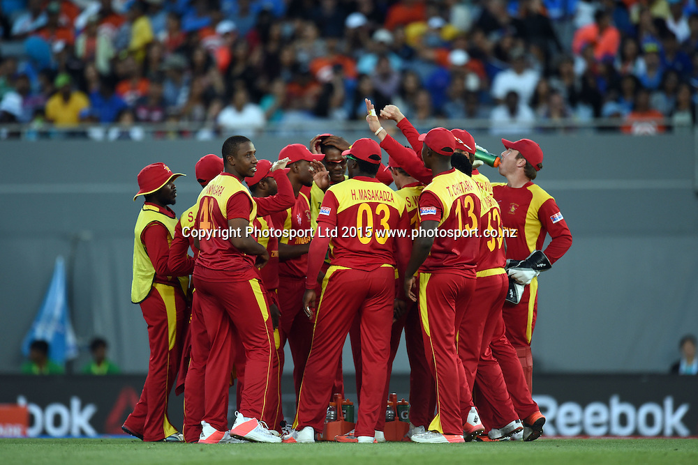 Zimbabwe players celebrate the wicket of Ajinkya Rahane during the ICC Cricket World Cup match between India and Zimbabwe at Eden Park in Auckland, New Zealand. Saturday 14 March 2015. Copyright Photo: Raghavan Venugopal / www.photosport.co.nz