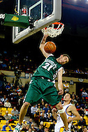 11/23/2006 - Anchorage, Alaska: On a breakaway, Senior guard Matt Lojeski (21) of the Hawaii Warriors goes for a dunk as Hawaii defeats Hofstra 80-79 at the 2006 Great Alaska Shootout on Thanksgiving night<br />