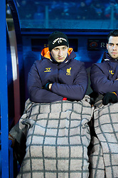 SAINT PETERSBURG, RUSSIA - Thursday, February 14, 2013: Liverpool's substitute Jonjo Shelvey wearing a blanket to keep warm on the bench during the UEFA Europa League Round of 32 1st Leg match at the Stadio Petrovski. (Pic by David Rawcliffe/Propaganda)