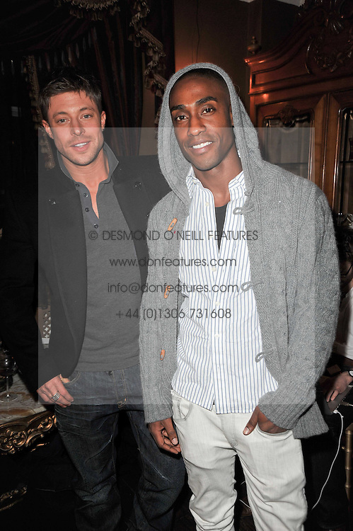 Left to right, DUNCAN JAMES and SIMON WEBBE from pop band Blue at a party to celebrate the publication of her new book - Kelly Hoppen: Ideas, held at Beach Blanket Babylon, 45 Ledbury Road, London W11 on 4th April 2011.