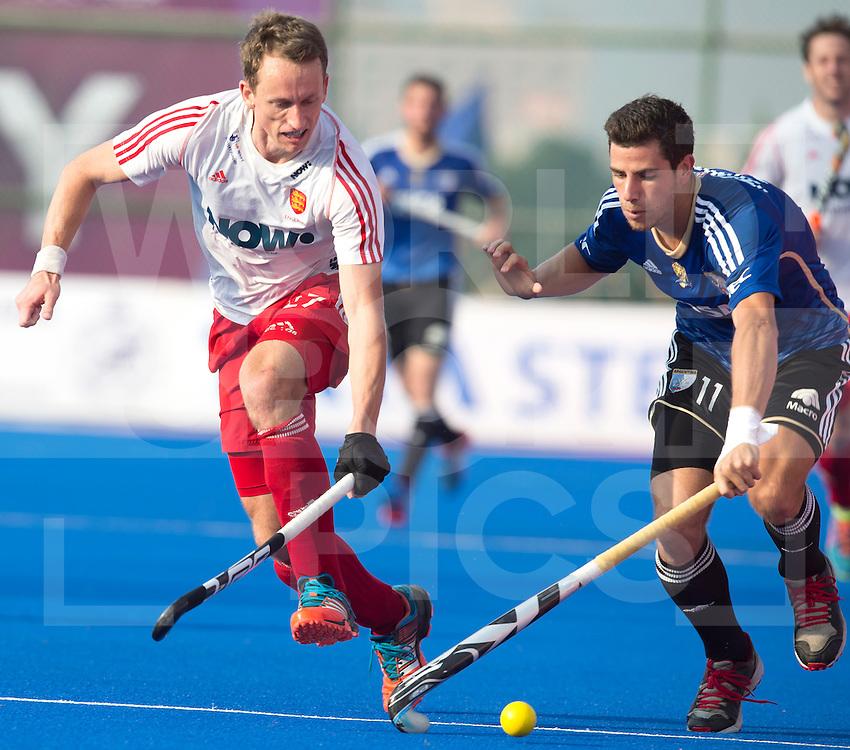 BHUBANESWAR (India) -  Hero Champions Trophy hockey men. match place 5-8. England vs Argentina (1-2).  Don Fox of England and Joaquin Menini of Argentina. Photo Koen Suyk
