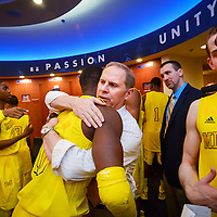 ANN ARBOR, MICHIGAN -- February 5, 2013 -- University of Michigan head coach John Beilein gives guard Tim Hardaway Jr. a hug after their game against rival Ohio State University in Ann Arbor, Michigan.  The Wolverines won 76-74 in overtime.   (PHOTO / CHIP LITHERLAND)
