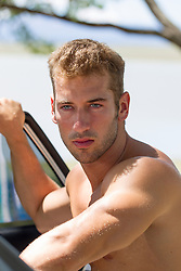 handsome shirtless man with blue eyes