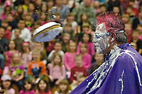 Jim Ferguson, the counselor at Hayden Meadows Elementary, patiently waits for the pie hurtling at his face to make impact.  .