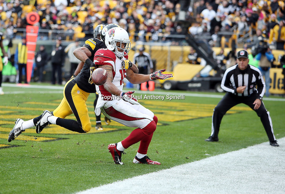 Pittsburgh Steelers defensive back Ross Cockrell (31) breaks up an end zone pass intended for Arizona Cardinals wide receiver Michael Floyd (15) on a third down play with less than one minute left in the first half during the 2015 NFL week 6 regular season football game against the Arizona Cardinals on Sunday, Oct. 18, 2015 in Pittsburgh. The Steelers won the game 25-13. (©Paul Anthony Spinelli)