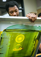 A student makes a screenprinted shirt in Wheelhouse Studios during Sunburst Festival at Memorial Union in 2014.