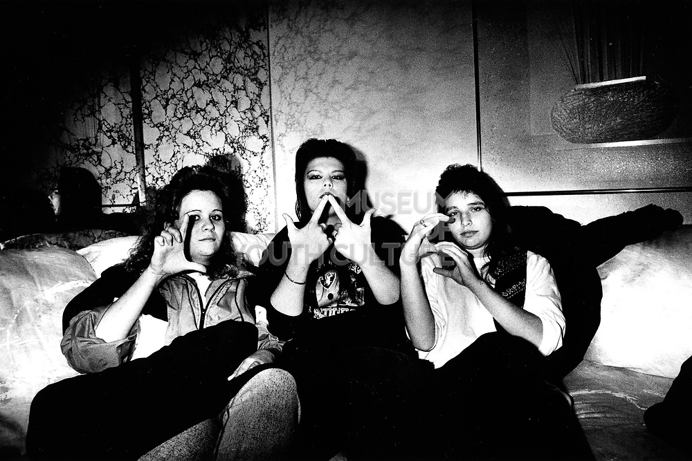 A female gang gesturing, LA, USA, 1990's