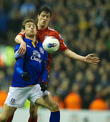 LIVERPOOL, ENGLAND - Tuesday, March 13, 2012: Liverpool's Martin Kelly in action against Everton's Nikica Jelavic during the Premiership match at Anfield. (Pic by David Rawcliffe/Propaganda)