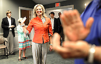 SIMPSONVILLE, SC: Waving hello to a clapping crowd of supporters, Ann Romney, wife of republican candidate for president, Mitt Romney, enters the City Hall in Simpsonville, South Carolina, Thursday, September 29, 2011. (Photo by Melina Mara/The Washington Post) . ...