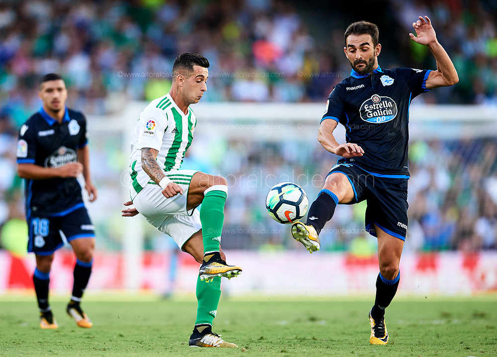 SEVILLE, SPAIN - SEPTEMBER 16:  Sergio Leon of Real Betis Balompie (L) competes for the ball with Adrian Lopez of RC Deportivo (R) during the La Liga match between Real Betis and Deportivo La Coruna  at Estadio Benito Villamarin on September 16, 2017 in Seville, .  (Photo by Aitor Alcalde Colomer/Getty Images)