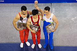 Second placed Samuel Piasecky of Slovakia, winner Pham Phuoc Hung of Vitnam and third placed Alen Dimic of Slovenia during trophy ceremony after the Parallel Bars during Final day 2 of Artistic Gymnastics World Cup Ljubljana, on April 27, 2013, in Hala Tivoli, Ljubljana, Slovenia. (Photo By Vid Ponikvar / Sportida.com)