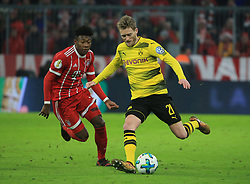 MUNICH, Dec. 21, 2017  Dortmund's Andre Schuerrle (R) vies with Bayern Munich's David Alaba during a German Cup 3rd round match between Bayern Munich and Borussia Dortmund, in Munich, Germany, on Dec. 20, 2017. Bayern Munich won 2-1 and advanced into quaterfinals. (Credit Image: © Philippe Ruiz/Xinhua via ZUMA Wire)