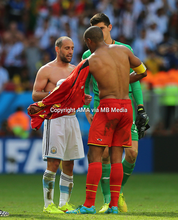 Vincent Kompany of Belgium swaps shirts with Manchester City team mate Pablo Zabaleta of Argentina