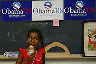 Sasha Obama, daughter of Democratic presidential hopeful Senator Barack Obama, eats ice cream as her mother Michelle Obama speaks to supporters during a rally in Concord, New Hampshire June, 2, 2007. .