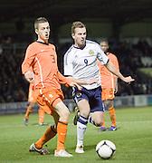 Holland's Jeffrey Gouweleeuw and Scotland's Jordan Rhodes - Scotland v Holland - UEFA U21 European Championship qualifier at St Mirren Park..© David Young - .5 Foundry Place - .Monifieth - .Angus - .DD5 4BB - .Tel: 07765 252616 - .email: davidyoungphoto@gmail.com.web: www.davidyoungphoto.co.uk