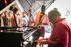 Ivanna Eudora Kean High School student Sherwin Williams plays alongside Arturo Sandoval.  Cuban Jazz trumpeter, pianist, and composer Arturo Sandoval plays alongside local high school and college musicians and answers questions about his life, inspiration, and performances at Reichhold Center for the Arts.  St. Thomas, USVI.  2 October 2015.  © Aisha-Zakiya Boyd