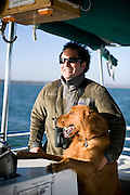 Captain Joe and dog aboard the Shamrock. aboard the Shamrock.