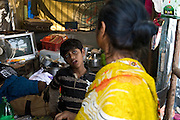 Azharuddin Ismail, 10, the child actor playing the role of 'young Salim', the brother of Jamal, protagonist of Slumdog Millionaire, the famous movie winner of 8 Oscar Academy Awards in December 2008, is arguing with his mother in their home inside the slum where they still live next to the train station of Bandra (East), Mumbai, India. Various promises were made to lift the two young actors (Azharuddin Ismail and Rubina Ali) from poverty and slum-life but as of the end of May 2009 anything is yet to happen. Rubina's house was recently demolished with no notice as it lay on land owned by the Maharashtra train authorities and she is now permanently living with her uncle's family in a home a stone-throw away in the same slum. Azharuddin's home too was demolished in the past two weeks, as it happens every year in his case, because the concrete walls were preventing local authorities to clear a drain passing right behind it. As usual, his father is looking into restoring the walls as soon as the work on the drain has been completed.