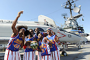 "The World Famous Harlem Globetrotters take a ""selfie"" on the flight deck of the Intrepid Sea, Air & Space Museum, Monday, Oct. 6, 2014, in New York, after playing an exhibition game to announce the dates for their 2014-15 North American Tour.   The Globetrotters will honor a ""Hometown Hero,"" a current or past member of the U.S. armed forces, at each stop on their tour.  (Photo by Diane Bondareff/Invision for the Harlem Globetrotters/AP Images)"
