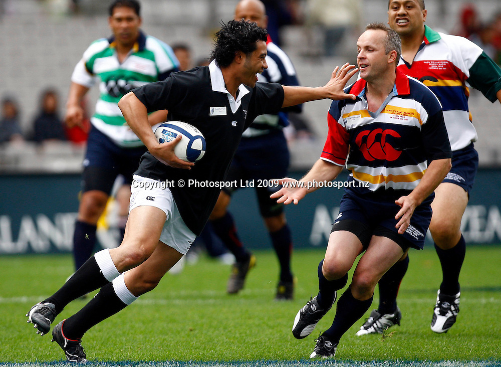 American Samoas Romi Ropati looks to fend Christian Cullen, Samoa Tsunami Celebrity Rugby Match, Samoa v American Samoa. Eden PArk, Auckland. 18 October 2009. Photo: William Booth/PHOTOSPORT