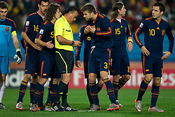 Carles Puyol of Spain,  referee Carlos Batres with yellow card for Gerard Pique of Spain and penalty shot for Paraguay during the  2010 FIFA World Cup South Africa Quarter Finals football match between Paraguay and Spain on July 03, 2010 at Ellis Park Stadium in Johannesburg. Spain defeated Paraguay 1-0. (Photo by Vid Ponikvar / Sportida)