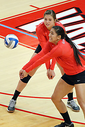 28 September 2014:  Stacey Niao  and Ashley Rosch during an NCAA womens volleyball match between the Evansville Purple Aces and the Illinois State Redbirds at Redbird Arena in Normal IL