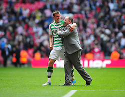 Yeovil Town's Kevin Dawson  and Yeovil Town Manger, Gary Johnson celebrate Yeovil Town's promotion into the Npower Championship after winning the League 1 Play-Off Final - Photo mandatory by-line: Dougie Allward/JMP - Tel: Mobile: 07966 386802 19/05/2013 - SPORT - FOOTBALL - LEAGUE 1 - PLAY OFF - FINAL - Wembley Stadium - London - Brentford V Yeovil Town