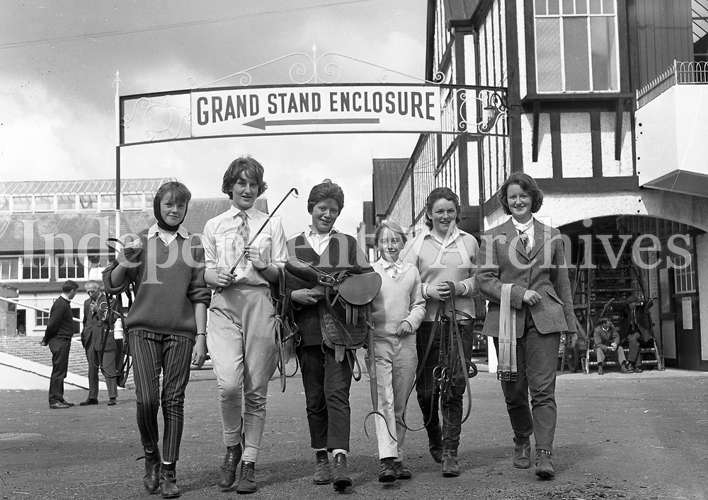 Jockeys at the RDS. Grand Stand Enclosure sign behind them, names and date unknown.<br />