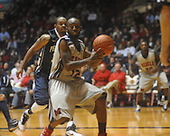 "Ole Miss guard Chris Warren (12) passes at the C.M. ""Tad"" Smith Coliseum on Friday, November 26, 2010. Ole Miss won 84-71."