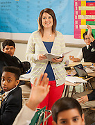Rebecca Millhench poses for a photograph with her 6th grade history class at Young Men's College Preparatory Academy April 26, 2013.